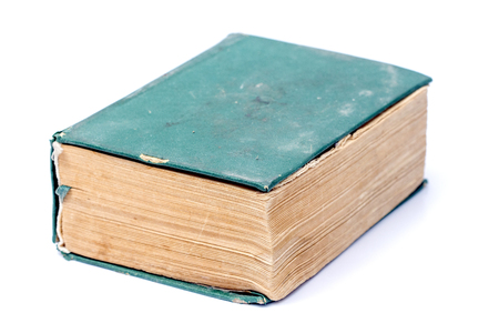 hard cover: Picture of a Single old hard cover green book isolated over white