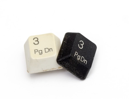 page down: picture of a dirty key from a computer keyboard isolated on a white Stock Photo