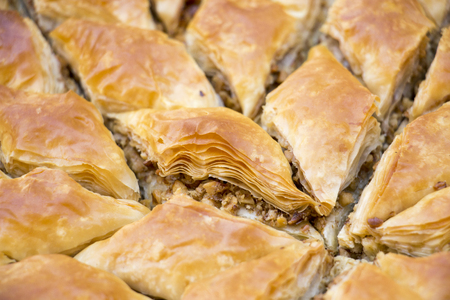 turkish dessert: picture of a Turkish dessert baklava with walnuts , macro Stock Photo