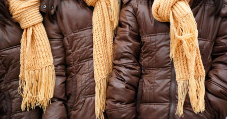 tricot: picture of a yellow woolen knitted shawls