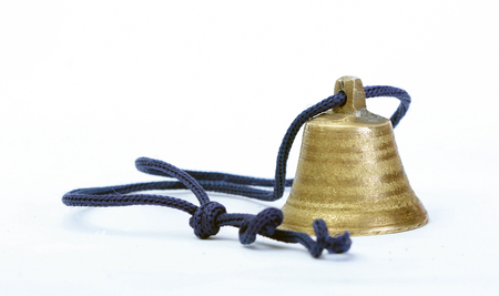 proclaim: Picture of a small bell on a whie background Stock Photo