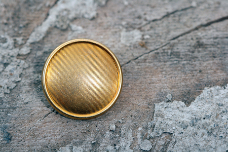 golde: picture of old used sweing button Stock Photo
