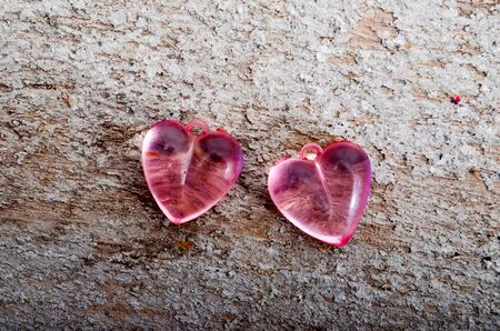 plastic heart: picture of a pink plastic heart on wood cement background. valentines day celebration concept.
