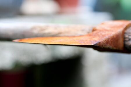 picture of an old rusty oxidated chopping axe