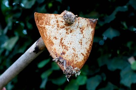 picture of an old rusty oxidated hoe.corrosion