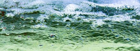 fluidity: many bubbles in water close up Stock Photo