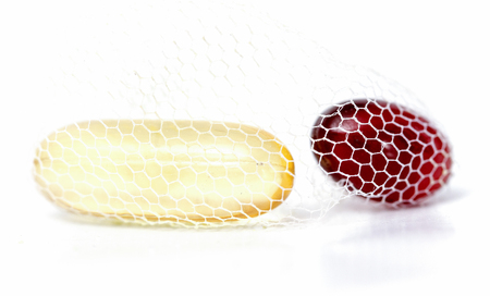 omega 3: picture of a Cod liver oil omega 3 and krill oil gel capsules in net