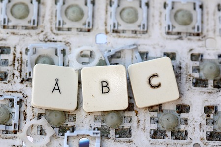 yellowed: A close view of some keys on a dirty, yellowed keyboard.letters a,b and c Stock Photo