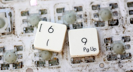 yellowed: A close view of some keys on a dirty, yellowed keyboard.numbers 6 and 9