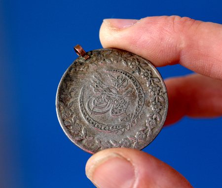 ottoman empire: picture of a Fingers hold old coin from Ottoman empire Stock Photo