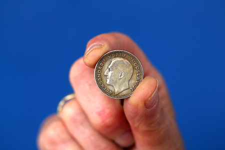 picture of a Fingers hold old coin from yugoslavia kingdom