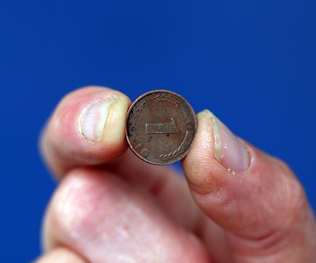 picture of a Fingers hold old coin from germany