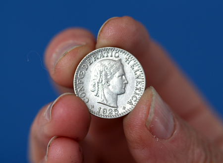 helvetia: picture of a Fingers hold old coin from switzerland