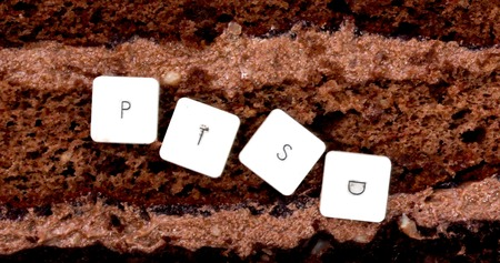 disturbing: picture of a PTSD keyboard letters on a chocolate cake background Stock Photo