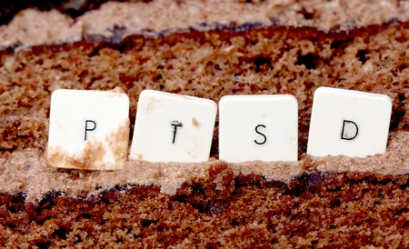 picture of a PTSD keyboard letters on a chocolate cake background Stock Photo