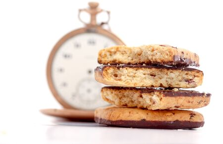 watch groups: picture of a Baking with chocolate an tape measure on a white background.Diet concept