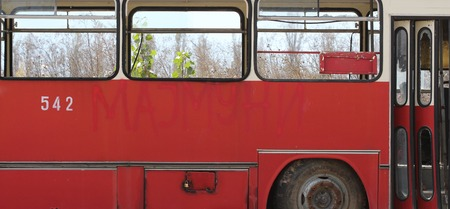 junked: picture of a Old red bus, abandoned and rusty.