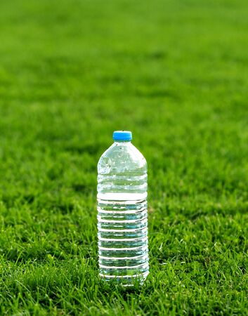 water bottles: picture of a plastic water bottle on a green grass