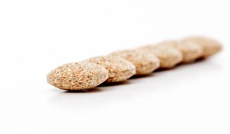 compress: Close Up of Plain Compress pills of Medicinal Herb Powder Stock Photo