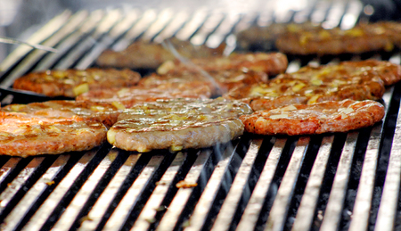 sizzle: picture of a Beef or pork meat with chehese barbecue burgers for hamburger prepared grilled on bbq fire flame grill