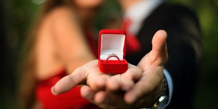 Engagement ring on womans hand held by her friend , picture of a Stock Photo