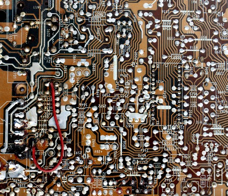 printed: Part of old vintage printed circuit board with electronic components. Stock Photo