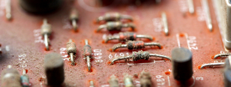 Part of old vintage printed circuit board with electronic components. Stock Photo