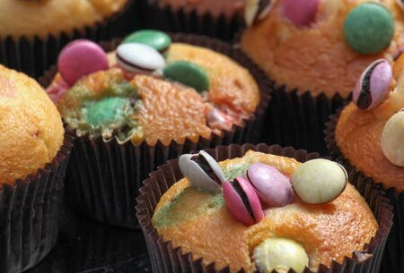 bonbons: picture of a light muffin with various sweets on top
