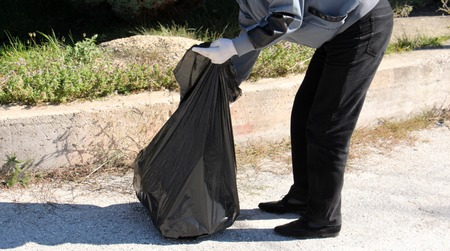 collecting: Cropped image of environmental activists collecting garbage