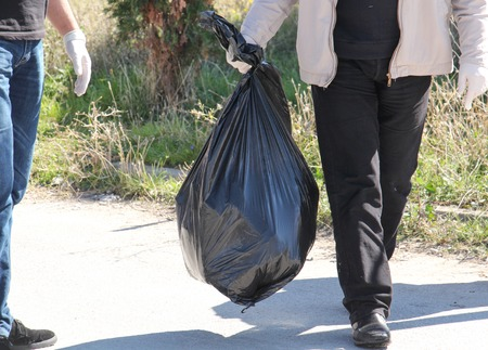 activists: Cropped image of environmental activists collecting garbage