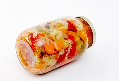 Mixed pickled vegetables in glass jar Stock Photo