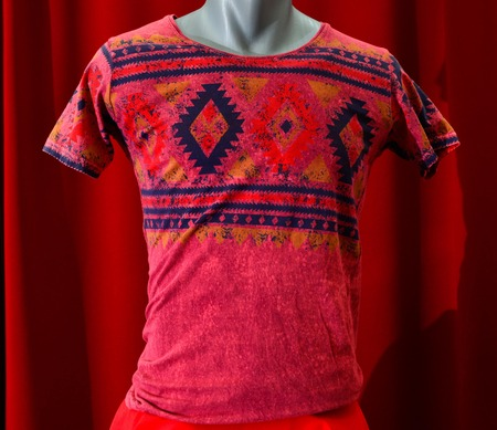 manequin: picture of a fashion summer clothes on a manequin doll on a red background Stock Photo