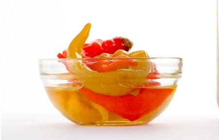 conserved: picture of a Isolated glass bowl with conserved chilli paprika
