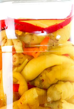 conserved: picture of a glass jar with conserved chilli paprika Stock Photo