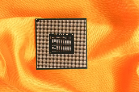 computer generation: picture of a new generation computer chip on fabric background, Stock Photo