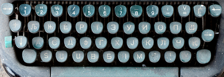 correspond: picture of a closeup of old disrty and dusty typewriter buttons