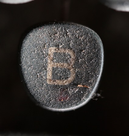 dirty sheet: picture of a closeup of old disrty and dusty typewriter buttons