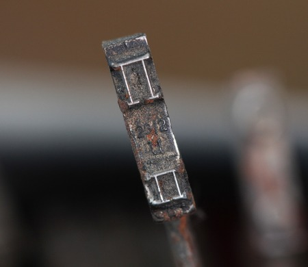 picture of a closeup of old disrty and dusty typewriter buttons