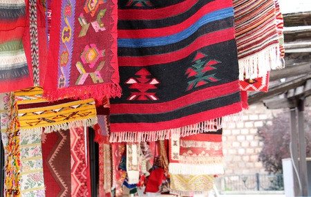 picture of a coooful macedonian hand made traditional woolen rugs. color concept