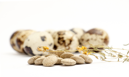 picture of a japanese quail eggs and herbal pills Stock Photo