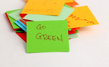 yellow notepad: picture of a Note papers on white background,go green concept Stock Photo