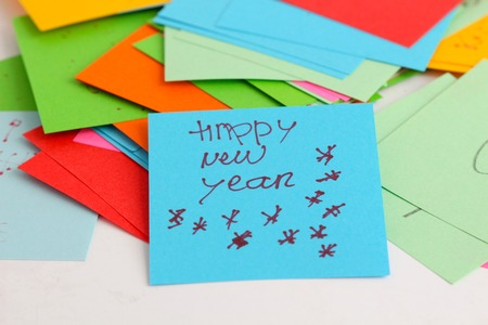 yellow notepad: picture of a Note papers on white background,text happy new year