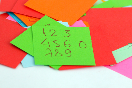 yellow notepad: picture of a Note papers on white background,numbers from one to zero