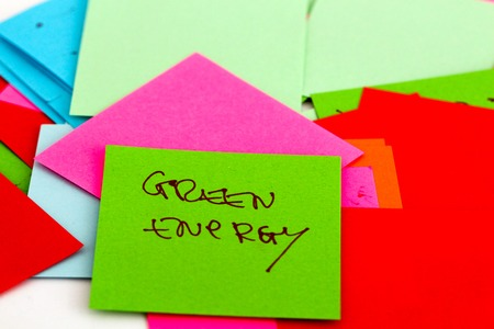 energy picture: picture of a Note papers on white background,text green energy,