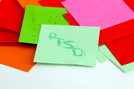 ilness: picture of a Note papers on white background,ptsd text Stock Photo