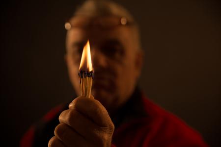 studio shot: hand holding Burning Matches. studio shot,close up,