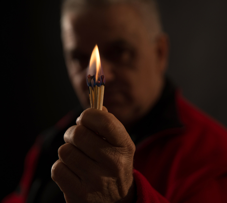 studio shot: picture of a hand holding Burning Matches. studio shot,close up,