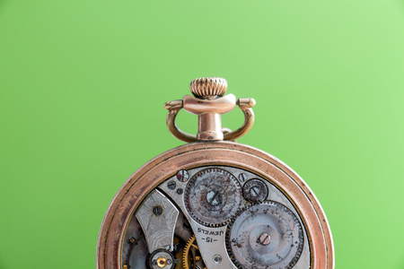 back in an hour: pictureof a Vintage pocket watch on green background
