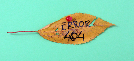 picture of a autumn walnut leaves with handwritten text error 404