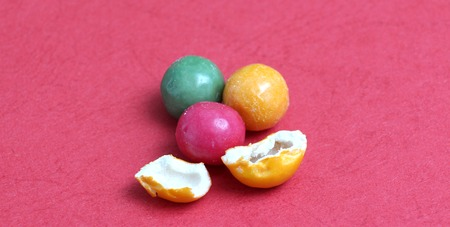 gumballs: picture of a colorful bubble gums on a red background